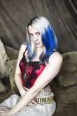 Beautiful Young Goth Woman with Blue Hair and Red Corset — Stock Photo