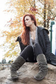 Young Woman with Beautiful Auburn Hair Posed on a Rock — Stock Photo