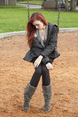 Very Unhappy Young Woman with Beautiful Auburn Hair on a Swing — Stock Photo