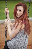 Young Woman with Beautiful Auburn Hair on a Swing — Stock Photo
