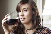 Beautiful Young Woman in Drinking Red Wine — Stock Photo