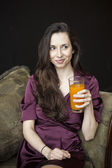 Beautiful Young Woman Holding Glass of Mango Juice — Stock Photo