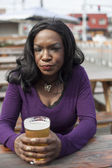 Angry Young African American Woman Drinks Pint of Pale Ale — Stock Photo
