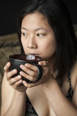 Beautiful Young Woman with Brown Hair and Eyes with Black Coffee — Stock Photo