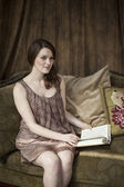 Young Woman with Beautiful Green Eyes Reading a Book. — Stock Photo