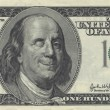 Smiling Ben Franklin with Wink - Stock Photo