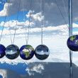 Newtons Cradle Earth - Stock Photo