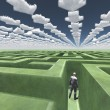 Figure inside of maze with arrow clouds above - Stock Photo