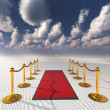 Red carpet in desert sands - Stock Photo