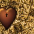 Locked heart and US currency background - Foto Stock