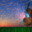 Cello emits light with clouds formed as musical notaions - Stock Photo