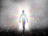 Man in rainbow light and stars — Stock Photo
