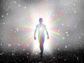 Man in rainbow light and stars — Stock Photo