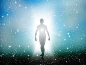 Figure emerges from the cosmos — Stockfoto