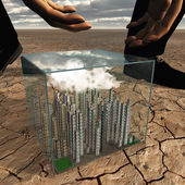 Tiny city in plastic box in desert landscape about to be picked — Stock Photo