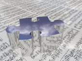 Puzzle and sheet music reflecting clouds. — Stock Photo