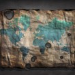 World Map on old distressed Paper — Stock Photo #29303395