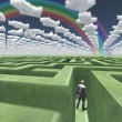 Man in maze with puzzle clouds — Stock Photo #29419525