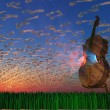 Cello emits light with clouds formed as musical notations — Stock Photo