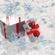 Open silver gift box with snowflake — Stock Photo