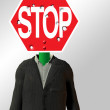 Stock Photo: Stop sign Headed Figure