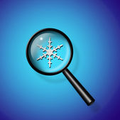 Snowflake under magnify glass — Stock Photo