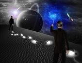Man points toward galaxy in science fiction scene — Stock Photo