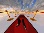 Black stilettos on red carpet — Stock Photo