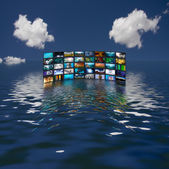 Multiple screens reflected in water — Stock Photo