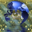 Eye peers through earth — Stock Photo