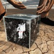 Stock Photo: Humabout to pick up box containing astronaut and space
