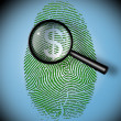 Stock Photo: Dollar Symbol in fingerprint under inspection