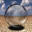 Crystal Sphere in desert depression — Stock Photo