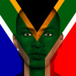 Stock Photo: South Africflag superimposed upon mans face