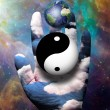Yin Yang and Earth hover above hand — Stok fotoğraf