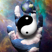 Yin Yang and Earth hover above hand — Zdjęcie stockowe