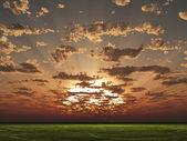 Sunset or sunrise over grass landscape — Stock Photo