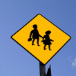 Traffic sign. Before school - Stock Photo