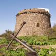 Sardinia. Portoscuso. Spanish Tower and old anchor — Stock Photo