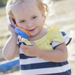 Adorable little cute girl with phone — Stock Photo
