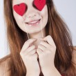 Stock Photo: Brunette girl with red hearts