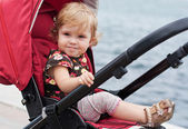 Happy baby in a stroller — Stock Photo