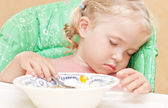 Little girl fell asleep at the table eating soup — Stock Photo