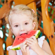 Cute little girl eating watermelon — Stock Photo #30508195