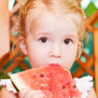 Cute little girl eating watermelon — Stock Photo #30508203