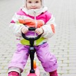 Baby girl on scooter — Stock Photo