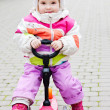 Stock Photo: Baby girl on scooter