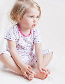 Adorable little girl in pajamas — Stock Photo