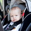 Baby boy in car seat — Stockfoto