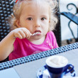 Funny toddler girl in cafe — Stok fotoğraf